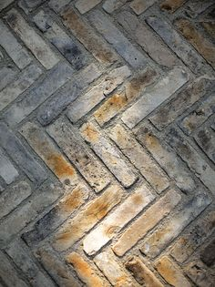 Shrader Design - gray brick reclaimed from China and layered in a herringbone pattern.