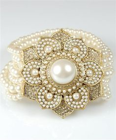 pearl bracelet.  Follow us @SIGNATUREBRIDE on Twitter and on FACEBOOK @ SIGNATURE BRIDE MAGAZINE