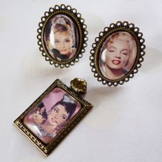 DiY Custom Image Jewelry.  I like the Audrey Hepburn jewelry.  Could use family photos or vacation destinations...anything.