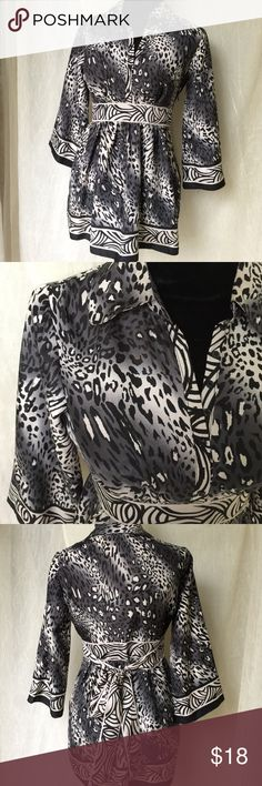 """Nicole Miller Black White Animal print Tunic Sz 4 Gorgeous. Nicole Miller. Size 4.  Button closure at top. Empire Waist. Tie Back, side zipper  100% polyester, machine wash cold, tumble dry, low iron.  Shoulder  (appx. 15.5"""" back)   Length (collar to back hem) appx. 27"""" Sleeve (shoulder to sleeve hem) appx. 18""""   Bust (armpit to armpit front):  appx. 16"""" Nicole by Nicole Miller Tops"""