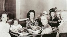 1946. August. In a Chinese restaurant, from left to right, making the round: Berniece Mona Rae, Grace Goddard, unidentified person, Norma Jean, Ana Lower and Gladys Monroe.