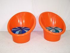 i have one of these in white but it had a black vinyl cover that stretched over it not the pillow seats. very cool like this tho.  Vintage retro Danish plastic pod garden chairs + table vintage designs 60s 70s