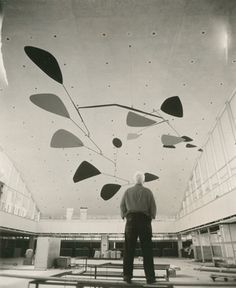 Calder reviewing the installation of .125, Idlewild Airport (now John F. Kennedy International Airport), New York, 1957