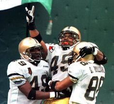 05 December 1998 - Philadelphia, Pennsylvania: Army's full back Ty Amey (#45) rejoices with teammates Bobby Williams (#49) and Gary Williams (#88) after scoring Army's winning touchdown during fourth quarter Army-Navy football action at Veterans Stadium December 5, 1998 . Army defeated Navy 34-30. UPI jca/rw/Shawn P. Anderson