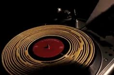 Cleaning a vinyl record with wood glue, wait for the satisfying peel sound...