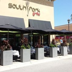 SOUTH FORK GRILL @ Coconut Point Mall looks great using our CityScape planters in their outdoor patio. #westelmlocal #southforkgrill #planters #