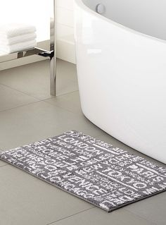 Exclusively from Simons Maison Fashionable urban travel style with the names of big cities written in a graphic stencil look. Modern, trendy pure white and charcoal grey. Ultra soft and smooth polyester microfibre Non-skid backing 50 x 80 cm Striped Bath Mats, House Styles, Rugs, Home Accessories, Bath Mat, Bathroom Renos, Home Decor, Small Bathroom Renos, Bath Rugs