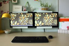Wall-mounted dual monitors for look at plans and then bidding with no minimizing windows.
