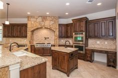 I like the corner kitchen.  Notice the prep sink in the island.  I'm not saying this specific layout of cabinets, etc. but the amount of space and the orientation is really nice.  Very spacious!  1401 Roaring Frk, Leander, TX 78641 is For Sale - Zillow