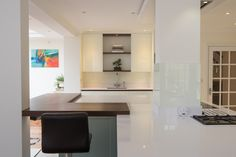 Supporting columns in a kitchen can be integrated into a purpose-built island Bottle Rack, Minimalist Kitchen, Contemporary, Modern, Island, Columns, Storage, Easy Access, Interior