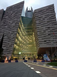 Guangzhou Library This building looks sloped and seems going to full and the great area made by mirror makes it seem more magic