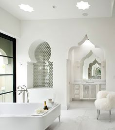 Moroccan style bathroom - notice the space designated for champagne!