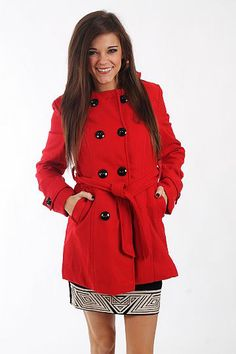 "The Charlie Pea Coat, Red $46.00  This coat is absolutely divine! The vibrant red color is b-e-a-utiful and we love the double rows of buttons up the front, longer length and belted waist. But our favorite part is the black and white fleecy plaid in the hood!!!   Fits true to size. Miranda is wearing a small.   From shoulder to hem:  Small - 29.5""  Medium - 31""  Large - 32.5"""