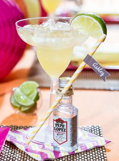 Wrap name tags around paper straws and attach with string to mini tequila bottles to create place cards for your Cinco de Mayo party place settings! | Smarty Had A Party