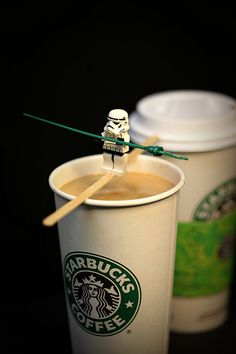 Stormtrooper LEGO acrobat works a balance beam over a cup of Starbucks coffee LIKE A BOSS.