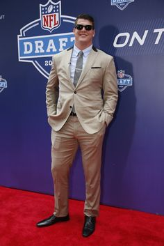 "#14: Taylor Lewan — Two sizes too small plus light-colored thin fabric and a sudden Western detail is not red-carpet appropriate, but probably equals a fun night out. Loving the ""Risky Business"" Wayfarers. [Photo by John Aquino]"