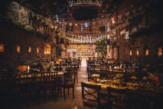 Lyde Court winter wedding decorated with bunting, fairylights, candles and a large Christmas tree