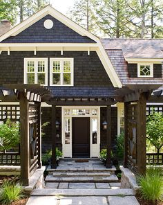 I love how the cedar shakes on the gambrel roof are broken up by white trim and sloping of the facade. It really give this Dutch Colonial dimension. Love the windows on the gambrel roof.