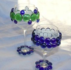 Bejeweled Wine Glasses - Here's a fun kids craft that will spruce up your table for any Jewish holiday. These Bejeweled Wine Glasses work especially well as a Passover craft for the four cups of wine that are drunk during the seder. This is a good Jewish arts craft project for kids because it's so easy to make.