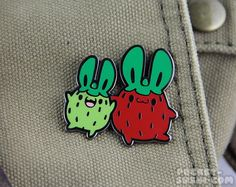 The Strawberry Bunny hard enamel lapel pin measures 1.7 inches (43mm) at its widest point and is cut from zinc alloy and plated in black nickel. The fastener is made from black rubber. The artwork was personally designed by the shop owner. !!! FREE SHIPPING !!! Use the coupon code