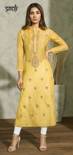 Bask in the sunlit perfection of this yellow and gold Kurti by Soch. The straight-cut silk kurti is woven with golden embroider adding the right amount of glamour to your outfit. Salwar Dress, Salwar Suits, Anarkali, Salwar Kameez, Silk Kurti, Churidar Designs, Indian Attire, Embroidered Silk, Indian Designer Wear