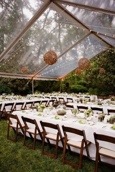 Choosing a clear tent for an outdoor wedding gives the impression of dining and dancing in a greenhouse. It is stunning during the day with its glass effect but even more beautiful at night- with the lights gleaming right through the tent.