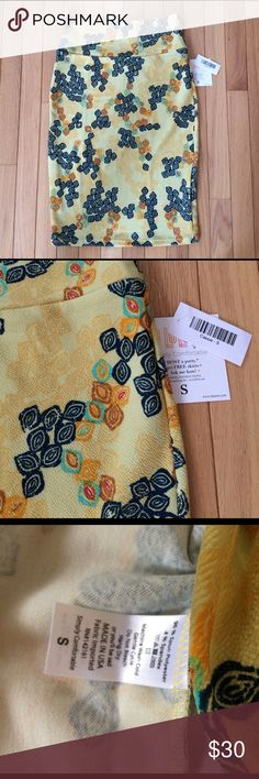 Lularoe Buttery Yellow Cassie Skirt S NWT Buttery yellow, spring colored Cassie! Stretchy pencil skirt made in the USA! Brand new with tags. LuLaRoe Skirts Pencil