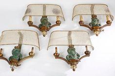 Maison Asselbur Suite de Quatre appliques à armature en laiton doré