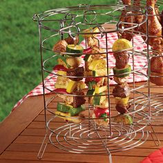 Kabob Holder. Contains hanging rack 8 skewers and 8 locking pins.Dishwasher-safe.Each skewer measures approximately: 9.88''W.  http://click.linksynergy.com/link?id=MQWvUTzqMG0&offerid=294781.9918789&type=2&murl=https%3A%2F%2Fcharbroil.affiliatetechnology.com%2Fredirect.php%3Fnt_id%3D5%26url%3Dhttp%3A%2F%2Fwww.charbroil.com%2Fkabob-holder-for-the-big-easy.html