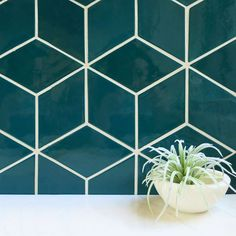 Using a dark tile color paired with white grout really accentuates the beautiful lines created by our Diamond Tiles😍Medium Diamonds - 29 Lake Calhoun