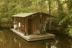 Tiny House Boat! I want to live here. It's perfect... Small house (less cleaning), gorgeous water, amazing forest, and you're closer to animals!(: