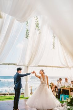 Outdoor tents come in all shapes and sizes—in other words, they're totally customizable. Deck out a clear-top tent with textured fabric drapings, rent colorful tie-backs to coordinate with your wedding color palette, you can even chose the exact table layout you want and where the dance floor should be | Event Direction by The Beach House Kauai | Oceanfront Wedding Reception | Tent Enhancement | Whimsical Wedding Inspiration | Beach Wedding | Wedding Photography by Meg Bradyhouse Tent Wedding, Wedding Beach, Wedding Fabric, Hawaii Wedding, Wedding Vows, Wedding Reception, Dream Wedding, Beach House Kauai, Beach House Restaurant