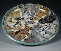 Hand Painted Pottery with Animal and Dog Art by Nan Hamilton Boston MA   Eight dogs and a wolf hanging out together in this shallow bowl