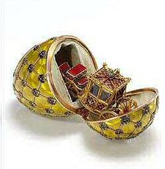 Coronation Egg, gift from Tsar Nikolai II to his wife, 1897. The surprise is a reproduction of the carriage used by them at their coronation.
