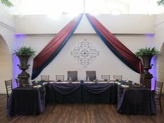 Head table on the dance floor with draping!