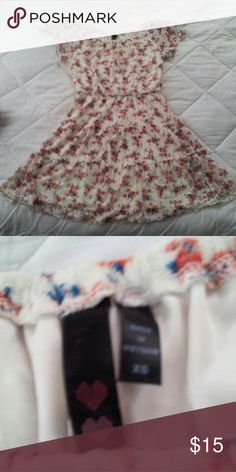 Floral unique dress Floral unique dress really comfortable juniors size small it stretches good condition.wore once for my brothers graduation Dresses Midi