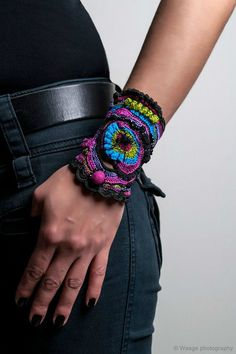 "handmade freeform crochet cuff - ""Pandora"" bracelet cuff with black-purple-pink-turquoise-green crochet lace Knitting PatternsKnitting HatCrochet PatronesCrochet Baby Textile Jewelry, Fabric Jewelry, Crochet Gloves Pattern, Crochet Patterns, Crochet Ideas, Cute Crochet, Crochet Lace, Lace Knitting, Crochet Bracelet"
