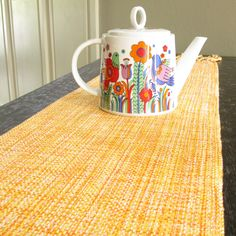 HandWoven Table Runner Table Decor Citrus Bright Yellow Orange Cotton Hand Woven Coffee Table Runner. $38.00, via Etsy.  But the reason I pinned it is the teapot. I love the design.