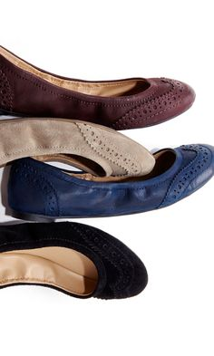 Ballet flats with wingtip detail and ruching at sides. Features rubber outsoles for extra comfort.