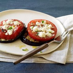 Eggplant slices are brushed with a lemon-herb mixture, grilled and then topped with juicy tomatoes and salty feta. Great hot or at room temperature.
