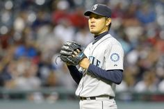 Starting pitcher Hisashi Iwakuma of the Seattle Mariners reacts after...