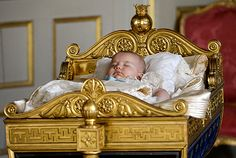 Prince Alexander in Karl XV's cradle after the christening ceremony.