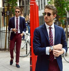 Colored pants and jacket with sunglasses.