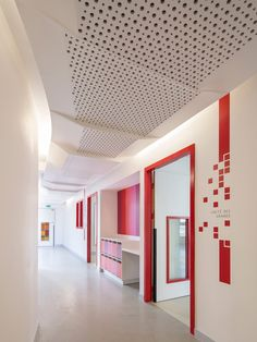 rh + architecture accents parisian childcare center in red