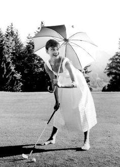 "Audrey ""playing"" golf"