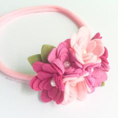 A fun, soft, and feminine pastel felt flower headband for you or your little wild and free flower child! This listing is for one pink, purple, and white cluster flower band. Each band includes one clu