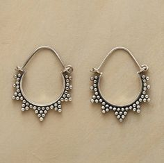 """Starburst rays handcrafted of granulation beads radiate from the perimeter of sterling silver hoops. Hinged wires. 1-1/4""""L."""