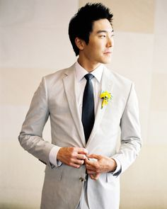 John wore a J.Crew suit and a boutonniere made of yellow craspedia and fabric.