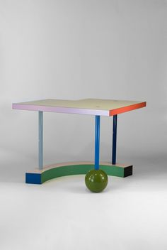 """Artist/Designer: Peter Shire b. 1947 California Title: Hollywood Table 1983 Medium: Wood, laminate and lacquer. Dimensions: 23.5"""" high x 29.5"""" x 29.5"""" Manufacturer: Memphis/Milano. Made in Italy. Deta"""