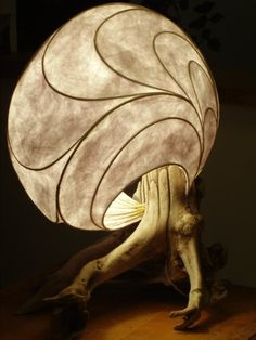 Molly was the first lightsculpture to come to life, in 2008. (handmade table lamp in driftwood, reeds, paper  resin).
